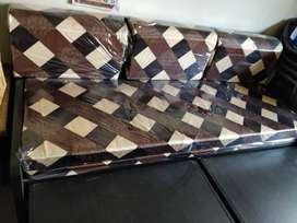 Wooden sofa cum bed with storage for sale.