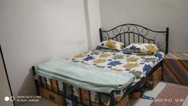 A Queen size (5×6ft) dismental iron bed with spring Mattress