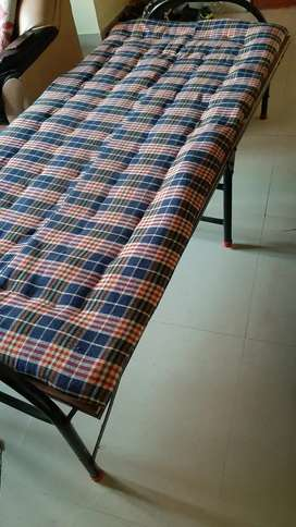 Folding cot with bed