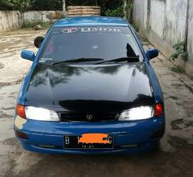 Mobil sedan Timor S515
