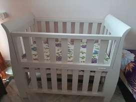 Baby cot white coloured..
