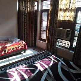 Fully furnished room with attached bathroom