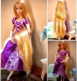 Doll rapunzal and barbie