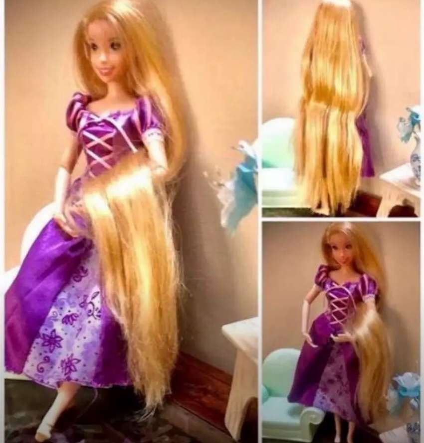 Doll rapunzal and barbie doll