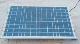 A Battery with solar plate. Govt ujaala program known as solar lamp So