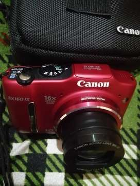 16MP Canon camera with box and cover