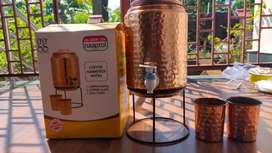 New Copper Water Dispenser with stand and two copper glasses.