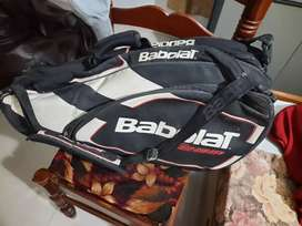 2 Tennis racquets and a babolat kit.
