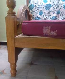Wooden cot with kurl on mattress