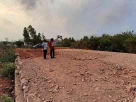 130 sq yrds vuda land at Ghambiram, 800 mts to NH. Near to colleges an