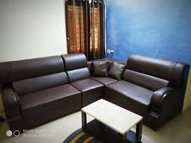 Brown L shape sofa