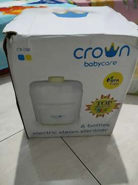 "Pensteril botol susu "" Crown baby care"""
