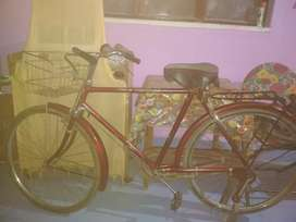 An old fashion bicycle . Ready to be sold