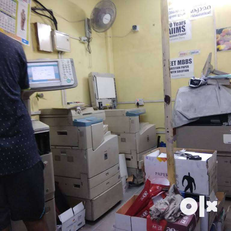 RUNNING PHOTOSTAT AND ONLINE CENTRE 0