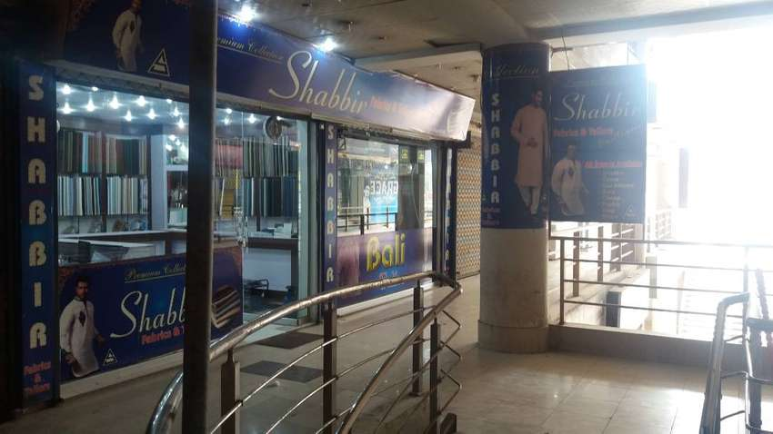 RUNNIG BUSSINESS FOR SALE...FABRIC SHOP..MAIN UNIVERSITY ROAD PESHWR. 0