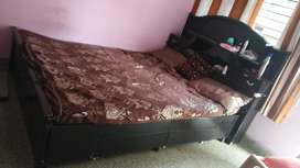 Wooden double bed with mattress and box