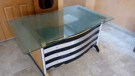 Big office table, size 5 foot by 3 foot. Thick designed glass,