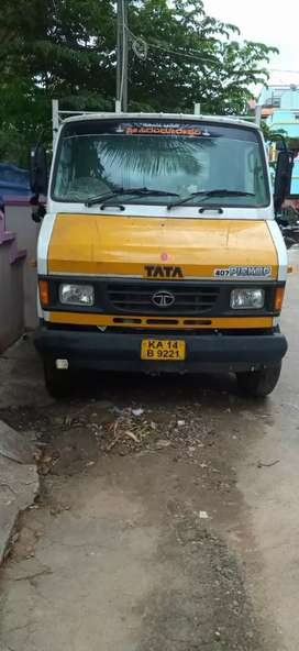 Tata 407 pickup white color
