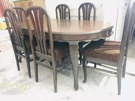 Six seater oval shaped dining table