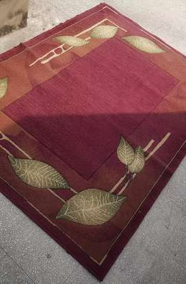Red rug with leaves