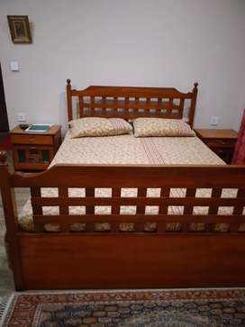 Wooden bed in good condition with sidetables.