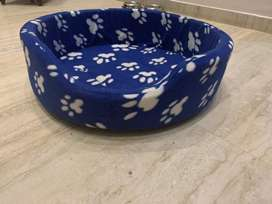 Blue & white paw print dog bed