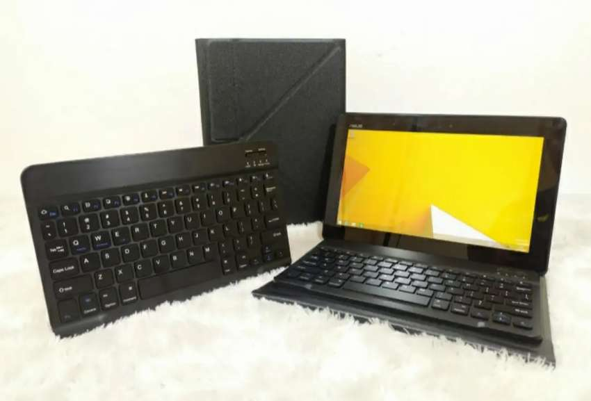 Tablet asus T100T  atom z3735 RAM 2gb ddr3  SSD 32gb touch screen