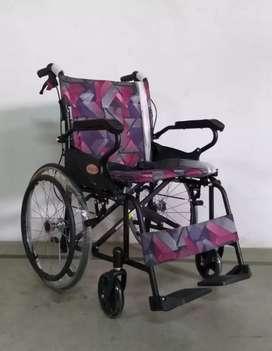 Kursi roda travelling ban besar motif