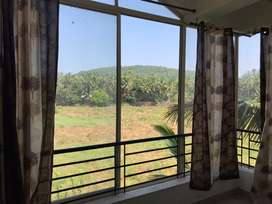 Field view flat for sale in Marna, Siolim