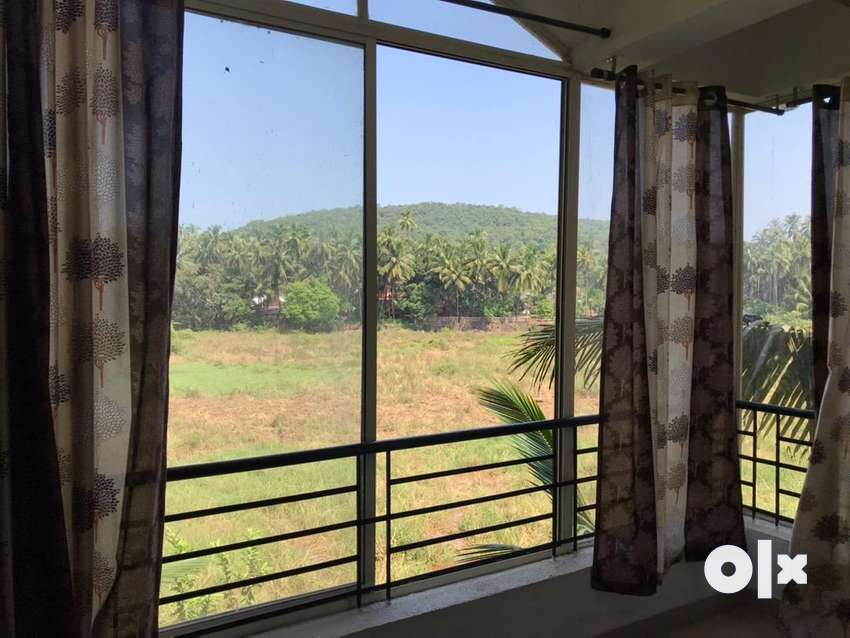 Field view flat for sale in Marna, Siolim 0