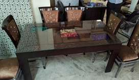 Stylish chair with 6 seater dining table at Satya furniture