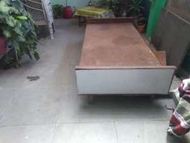 A wooden single bed is for sale.