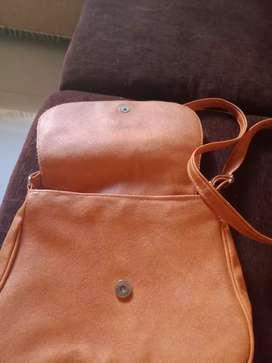 Sling bag long belt.good material .brown in colour