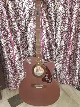 Brown colored acoustic guitar