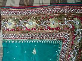 Brand new dark green colour saree used only once