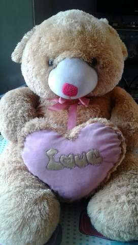 A yellowish teddy bear