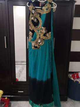 Saree gown Turquoise green black color medium size for sale.