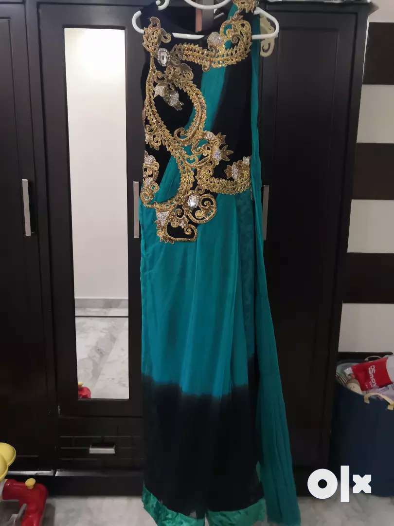 Saree gown Turquoise green black color medium size for sale. 0