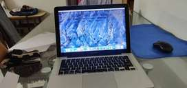 A Mac Book Pro price negotiable with charger