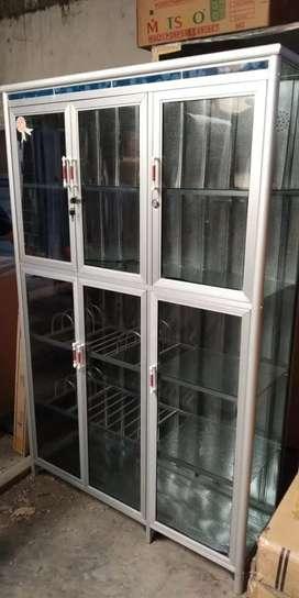 Lemari piring 3 pintu kaca riben ful.plat