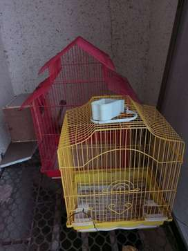 2 bird cages - red big one with wooden nest