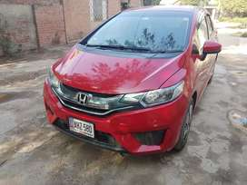Red Honda Fit 2014 model