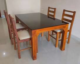 Wooden dining table set available