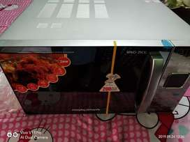 Microwave oven 25 CG New condition not use under warrenty