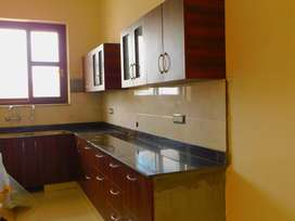 3 bhk with 2 bathrooms attached balcony , kitchen centrally located