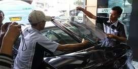 Lapak pemasangan kaca film mobil gedung