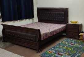Double bed with side tables and dressing table
