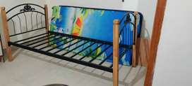 Wrought iron bed with wooden legs-6*4ft ( w/o mattress)