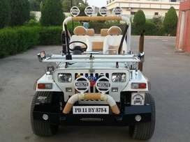 Full modified Open White Jeep ready your booking