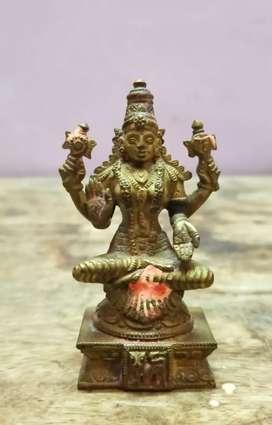 Antique brass idol